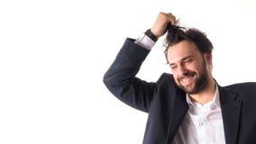 Ευτυχής επιχειρηματίας που χαίρεται για την τύχη και που κρατά την τρίχα του απομονωμένη στο λευκό Στοκ Εικόνες