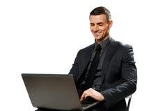 Ευτυχής επιχειρηματίας που χρησιμοποιεί το lap-top Στοκ Εικόνες