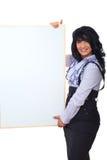 Ευτυχής επιχειρησιακή γυναίκα με το έμβλημα Στοκ Εικόνα