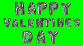 Ευτυχής ημέρα βαλεντίνων λέξης από τις ασημένιες επιστολές μπαλονιών ηλίου που επιπλέουν στην πράσινη οθόνη - απόθεμα βίντεο