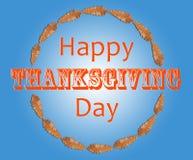 Ευτυχής ημέρα των ευχαριστιών με το καφετί φύλλο στον κύκλο μέσα στο μπλε Στοκ Εικόνες