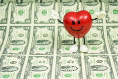 Ευτυχής καρδιά σε πολλούς $2 λογαριασμούς Στοκ Εικόνα