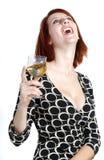 Ευτυχής νέα γυναίκα με ένα ποτήρι του κρασιού στοκ φωτογραφία με δικαίωμα ελεύθερης χρήσης