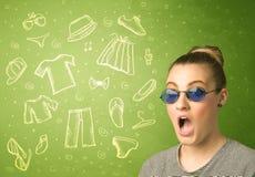 Ευτυχής νέα γυναίκα με τα γυαλιά και τα εικονίδια περιστασιακών ενδυμάτων Στοκ φωτογραφία με δικαίωμα ελεύθερης χρήσης