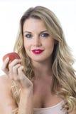 Ευτυχής νέα γυναίκα που κρατά την κόκκινη Apple Στοκ εικόνα με δικαίωμα ελεύθερης χρήσης