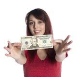 Ευτυχής νέα γυναίκα που παρουσιάζει 20 αμερικανικό δολάριο Μπιλ στοκ φωτογραφία