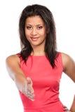 Ευτυχής νέα γυναίκα που προσφέρει την παλάμη χεριών για τη χειραψία Στοκ φωτογραφία με δικαίωμα ελεύθερης χρήσης