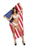 Ευτυχής νέα γυναίκα σε ένα υπόβαθρο της αμερικανικής σημαίας Στοκ Εικόνες