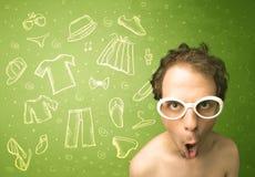 Ευτυχής νεαρός άνδρας με τα γυαλιά και τα εικονίδια περιστασιακών ενδυμάτων Στοκ εικόνα με δικαίωμα ελεύθερης χρήσης