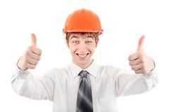 Ευτυχής νεαρός άνδρας στο σκληρό καπέλο Στοκ φωτογραφία με δικαίωμα ελεύθερης χρήσης