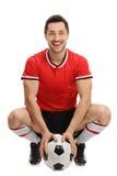 Ευτυχής ποδοσφαιριστής με μια σφαίρα Στοκ Εικόνες