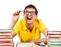 Ευτυχής σπουδαστής με βιβλία Στοκ Φωτογραφίες