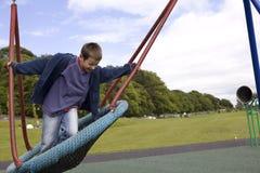 ευτυχής ταλάντευση παι&delt Στοκ φωτογραφία με δικαίωμα ελεύθερης χρήσης