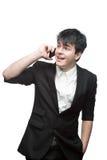 Ευτυχής χαμογελώντας επιχειρηματίας που μιλά στο τηλέφωνο κυττάρων Στοκ φωτογραφία με δικαίωμα ελεύθερης χρήσης