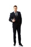 Ευτυχής χαμογελώντας επιχειρηματίας με τους αντίχειρες επάνω στοκ φωτογραφία