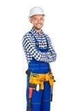 Ευτυχής χαμογελώντας εργάτης οικοδομών στην ομοιόμορφη και ζώνη εργαλείων με Στοκ εικόνα με δικαίωμα ελεύθερης χρήσης