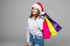 ευτυχής ψωνίζοντας γυν&alpha πωλήσεις λευκό απομόνωσης δώρων Χριστουγέννων Ψωνίζοντας κορίτσι Χριστουγέννων που απομονώνεται στο  Στοκ φωτογραφία με δικαίωμα ελεύθερης χρήσης
