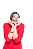 Ευτυχής όμορφος συν τη γυναίκα μεγέθους στο κόκκινο φόρεμα που κοιτάζει στο somethin Στοκ Εικόνες