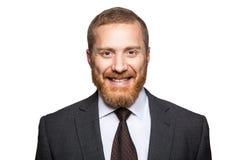 Ευτυχής smilely επιχειρηματίας που εξετάζει τη κάμερα με το οδοντωτό χαμόγελο Στοκ Εικόνες
