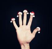 Ευτυχή δάχτυλα προσώπου Χριστουγέννων που εξετάζουν το κενό υπόβαθρο Στοκ Εικόνες