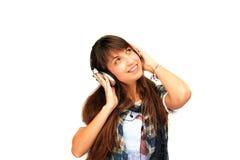 ευτυχή ακουστικά κοριτσιών στοκ εικόνα