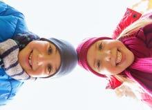 Ευτυχή πρόσωπα αγοριών και κοριτσιών Στοκ Εικόνες