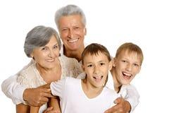 Ευτυχείς παππούδες και γιαγιάδες και εγγόνια Στοκ Εικόνες