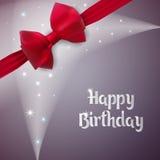 Ευχετήρια κάρτα για μια επέτειο γενέθλια ευτυχή Γκρίζο υπόβαθρο με το φως και τα αστέρια Το δώρο γέννησης είναι διακοσμημένο με έ Στοκ Εικόνες