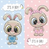 Ευχετήρια κάρτα ντους μωρών με το αγόρι και το κορίτσι κουνελιών Στοκ Εικόνες