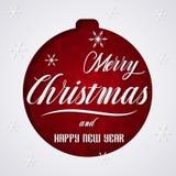 Ευχετήρια κάρτα Χαρούμενα Χριστούγεννας με τη σφαίρα Χριστουγέννων Στοκ Φωτογραφία