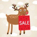 Ευχετήρια κάρτα Χριστουγέννων με τα ελάφια και την τσάντα πώλησης. Στοκ Εικόνες