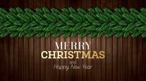 Ευχετήρια κάρτα Χριστουγέννων με τους κλάδους χριστουγεννιάτικων δέντρων στο ξύλινο υπόβαθρο απεικόνιση αποθεμάτων