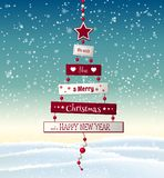 Ευχετήρια κάρτα Χριστουγέννων με το αφηρημένο δέντρο με το κείμενο στοκ φωτογραφία