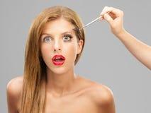 'Εφαρμογή' mascara της έκπληκτης &p Στοκ Εικόνα