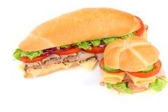 Εύγευστα σάντουιτς ζαμπόν, τυριών και σαλάτας Στοκ φωτογραφία με δικαίωμα ελεύθερης χρήσης