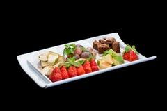 Εύγευστη σαλάτα φρούτων στο πιάτο Στοκ Φωτογραφίες