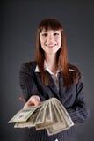 Εύθυμη επιχειρησιακή γυναίκα με τα δολάρια Στοκ Εικόνες