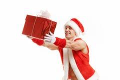Εύθυμη ικανότητα Santa που κρατά ένα κόκκινο κιβώτιο Στοκ Εικόνες