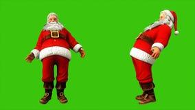 Εύθυμος Άγιος Βασίλης προσπαθεί να σταθεί σε κάτι και ταλαντεύεται στην πράσινη οθόνη κατά τη διάρκεια των Χριστουγέννων 4k Άνευ  απεικόνιση αποθεμάτων