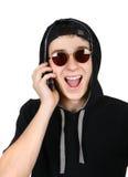 Εύθυμος έφηβος με το κινητό τηλέφωνο Στοκ Φωτογραφίες