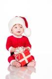 Εύθυμος λίγος Άγιος Βασίλης με παρουσιάζει.  Στοκ Εικόνα