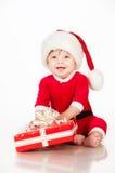 Εύθυμος λίγος Άγιος Βασίλης με παρουσιάζει. Στοκ φωτογραφία με δικαίωμα ελεύθερης χρήσης