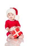 Εύθυμος λίγος Άγιος Βασίλης με παρουσιάζει. Στοκ εικόνες με δικαίωμα ελεύθερης χρήσης