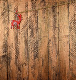 Ελάφια σε ένα ξύλινο υπόβαθρο νέο έτος Χριστούγεννα Στοκ φωτογραφίες με δικαίωμα ελεύθερης χρήσης