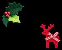 Ελαιόπρινος Χριστουγέννων με τα κόκκινους μούρα και τον τάρανδο Στοκ Εικόνα