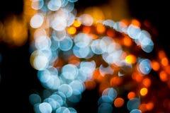 Ελαφριά περίληψη πόλεων νύχτας Χριστουγέννων Bokeh στο μαύρο υπόβαθρο Στοκ Εικόνα