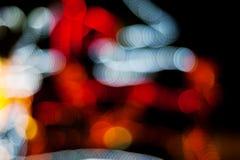 Ελαφριά περίληψη πόλεων νύχτας Χριστουγέννων Bokeh στο μαύρο υπόβαθρο Στοκ Φωτογραφία