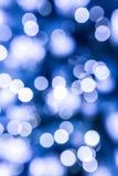 Ελαφριά σημεία στο μπλε υπόβαθρο Στοκ εικόνα με δικαίωμα ελεύθερης χρήσης