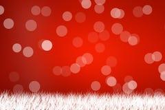 Ελαφρύ χιόνι στο κόκκινο υπόβαθρο με τη χλόη Στοκ Εικόνες