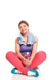 Ελκυστική γυναίκα 50 χρονών με ένα μπουκάλι νερό Στοκ Εικόνα